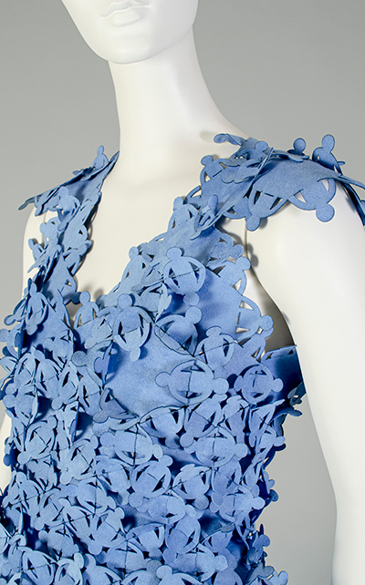 Detail of the light blue suede sleeveless top