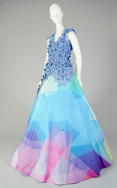 Side view of the blue top and multi-colored skirt on a mannequin