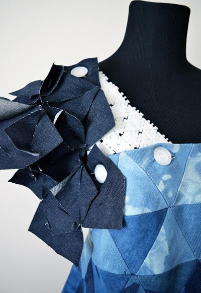 Detail, close up of blue, short dress