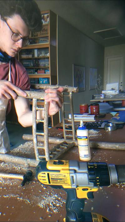 Christopher Novinski working on his sculpture