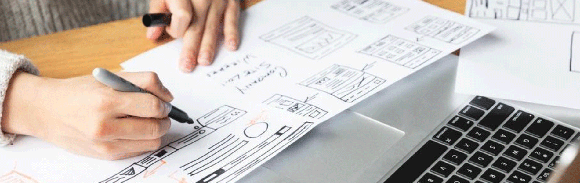 Research phase of user interaction design, hands shown drawing a user flow chart