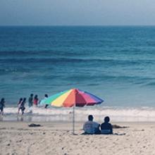 People sitting on a beach, ocean