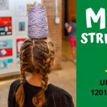 Child with yarn on her head for Mulberry Street Studio for kids