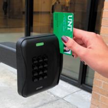 Hand swiping an ID card through the card reader