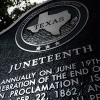 Detail, close up of the top of the Juneteenth Historical Marker
