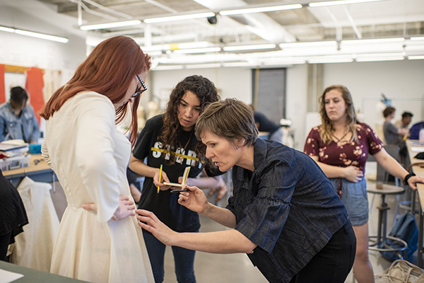 Barbara Trippeer and two students work on bespoke costumes for the fall 2019 opera